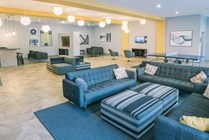 The community center complete with a coffee bar, TV's and a ping pong table is  a great place to relax with friends and meet other residents!